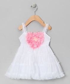 <p+style='margin-bottom:0px;'>Twirl+and+swirl+and+let+the+fun+unfurl+with+this+darling+dress.+With+its+tulle-topped+skirt+and+heart-shaped+blossoms+on+the+bodice,+this+is+a+frock+that+any+princess+would+be+pleased+to+wear.<p+style='margin-bottom:0px;'><li+style='margin-bottom:0px;'>100%+polyester<li+style='margin-bottom:0px;'>Machine+wash;+tumble+dry<li+style='margin-bottom:0px;'>Imported<br+/>