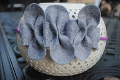 Cute felt headband:  4 felt bows and tucked into a ruffled strip of felt