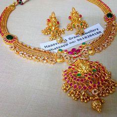 Stunning one gram gold necklace with big lakshmi devi pendant. Necklace studded with multi color stones. Necklace pendant with muvvalu hangigns. Ear studs designed lakshmi devi motifs. 21 February 2018