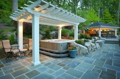 patio with hottub and pergula | Hot tub under the pergola – For a revitalizing dip!