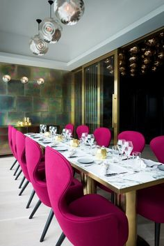 The LuxPad | New ALTO Restaurant Interiors by Tom Dixon | Glamorous interior surrounds ALTO, a contemporary new grill restaurant in Hong Kong. How dreamy are these bright pink chairs? Perfect for the VIP room!