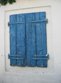 Blue shutters in Corfu
