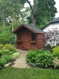Medium Classic with two ft.overhang and one 36 inch door and two windows.The Stain is Chocolate. Pine Garden, Backyard Sheds, Shed Storage, Solid Pine, Home Projects, Classic Style, Cottage, Cabin, Doors