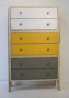 Furniture with distressed paint job look - like the idea of different coloured drawers - used in the right space....