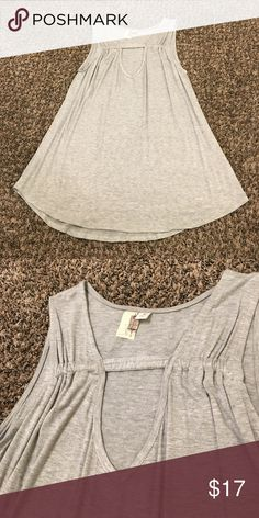 Flowing Deep V Tank Light gray, deep V Neck tank. Loose flowing fit. Great shirt for the summer months and as a swim cover up! Francesca's Collections Tops Tank Tops