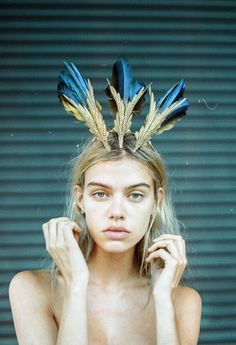 There are other ways to wear feathers in ones hair. Maybe creativity is all that is lacking in this world.