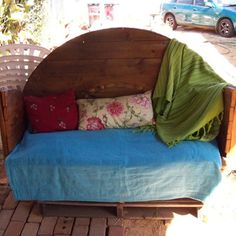 Upcycled cable drum into a couch for outdoors