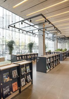 The first two floors of the NAVER headquarters have been transformed into a library, where bookshelves and the ambience were designed differently to best suit each book category. The library has three different zones – a desi. Public Library Design, Bookstore Design, Modern Library, Showroom Interior Design, Cafe Interior, Interior Architecture, Public Library Architecture, Grand Library, Library Cafe