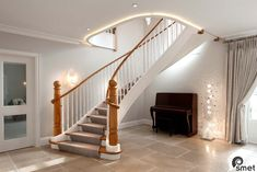Free-standing helical staircase with angled first step for a welcoming feel, entirely made of hardwood. Look at that handrail wrapping around the starting posts! Click to see more pictures of this classic Essex home.