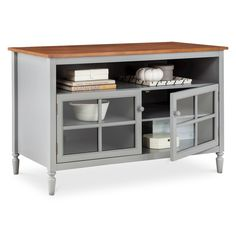 Keep that traditional look you love with the Isabella Glass Door Open Shelf TV Stand. The well turned legs have a classic touch that is emphasized by the natural wood top and cupboard doors. While looking like a stylish sideboard, this entertainment center has all the right cutouts in the back for you to feed wires as needed and a top that won't sag under the weight of your television. Forget the TV entertainment center of the past, this one has a quality look and feel that fits right in ...