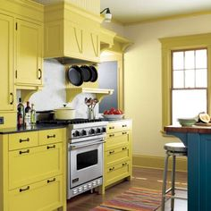 Yellow cabinets and blue island