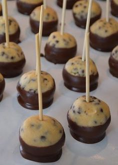 The Domestic Doozie: Chocolate Chip Cookie   Dough Bites 1/2 cup butter 1/4 cup sugar 1/2 cup brown sugar 3 tablespoons of   half and half 1 teaspoon vanilla 1 1/3 cup flour 2/3 cup mini chocolate chips    For the coating: 2 cups of chocolate chips (melted) 1 tablespoon   shortening