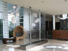 """Not with water, etc. but perhaps fogged glass with quotes, etc (or plain with hint of blue) to act as a divider to create more """"nooks"""""""