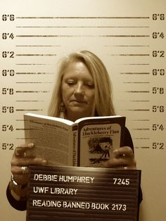 """Meet Debbie """"The Enforcer"""" Humphrey! When she's not keeping the library staff in check, she reads Adventures of Huckleberry Finn by Mark Twain despite its long history of censorship. #bannedbooksweek #freedomtoread"""