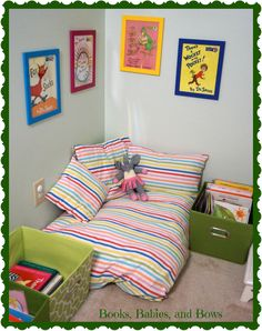 Creating a Space to Read- Book Nook for toddlers made from old linens, down comforters, and throw pillows.