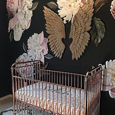 Friday night design inspiration! How amazing is this nursery with the insanely chic statement wall, rose gold crib and custom crib sheet.