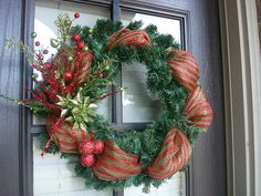 I love this!  Adding deco mesh to a cheap wreath form and embellish.