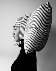 Everyone needs a pillow-wig. Joo Youn Paek.