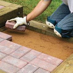 Brick treads framed with landscape timbers make attractive steps between different levels in your yard.