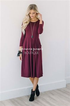 You can never have too many of our soft and comfy dresses! The thick and extra soft material will keep you cozy all winter long. Solid Wine dress features 3/4 length sleeves, cute pleated waist and side seam pockets.