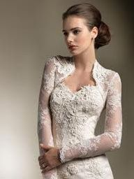 Love the sleek silhouette and all that lace. It's elegant and covered-up with the long-sleeved bolero, but still glamorous and sexy with the sweetheart neckline. So pretty!