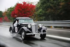 Taking on the rain in a 1952 MG