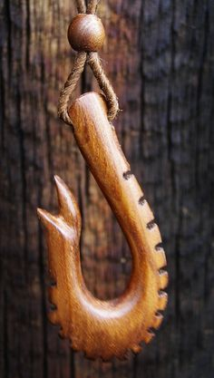 """Russian Olive Carved Tribal Warriors Fishing Hook, 1"""" x 2"""" x 1/4"""" thick, with Carved 1/4"""" Russian Olive Bead."""