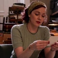 Millie's pretty aqua sweater and head scarf from Series 1 of The Bletchley Circle