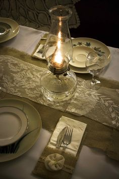 Burlap and lace place setting with table runner, mismatched China, kerosene lantern and church pew seating. See more rustic wedding ideas at mythreeweddings.com