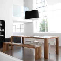 """Eaton Eaton, made of oil-treated and matte-finished solid wood, adapts perfectly to any interior. Available in European or American walnut, cherrywood, or natural oak. A choice of two depths is available as well as a choice of nine lengths for the fixed table and with the 19¾"""" (50cm) extension leaf. The longer lengths have an additional leg in the center of the table. Matching benches are available.  Live Beautifully! www.lignerosetsf.com  #Design #Living #LigneRosetSF"""