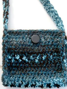 Available at Captola at Etsy.com Teal and black crochet purse called Sissy