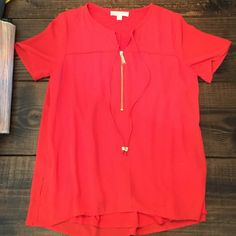 Michael Kors coral top New without tags. Size 8. Coral color with gold details. MICHAEL Michael Kors Tops Blouses