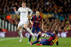 Gareth Bale of Real Madrid competes for the ball against Jordi Alba of FC Barcelona during the La Liga match between FC Barcelona and Real Madrid CF at Camp Nou on March 22, 2015 in Barcelona, Spain.