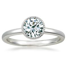 18K White Gold Sierra Ring from Brilliant Earth.  I like this setting if I am to use mom & dad's engagement ring's diamond.