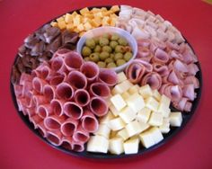 "easy party trays | ... and Swiss Cheeses with an Olive Garnish. 16"" tray serves 16-20"