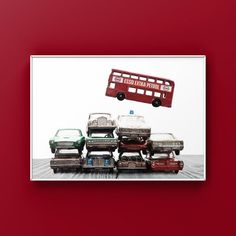 This listing is for one print of a stack of vintage lesney matchbox cars from the 50s all piled together with a Red Double Decker Bus jumping over them. Perfect for your boys room or nursery. These can also be personalized if you want. Please select either photo or canvas as well as the size youd Minimalist Room, Minimalist Home Decor, Boys Room Decor, Boy Room, Home Designer, Professional Photo Lab, Red Bus, Fall Home Decor, Gray Background