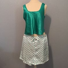 Victoria's Secret Pajama Set Small Very cute emerald green Victoria's Secret polyester pajama set! Shirt is a sleeveless crop top and shorts are polka dotted with a drawstring and elastic. Sized small, but could fit a medium. No known flaws.  No trades. Victoria's Secret Intimates & Sleepwear Pajamas
