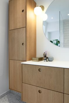 Reform's Basis bathroom design in natural oak with a countertop in white GetaCore. It's an IKEA hack.