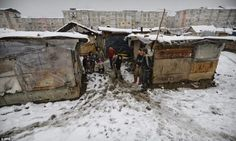 Harsh living: The bitter cold weather is difficult for the residents to endure in their make-shift homes in Baia Mare, Romania.
