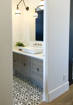 Beautiful tile and grey cabinets