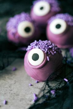 Beat Oreos and cream cheese together in a mixer and roll them up in balls to create truffle balls. Leave the balls in the fridge for a hour and then dip them into lavender candy melts to start transforming them into monsters.
