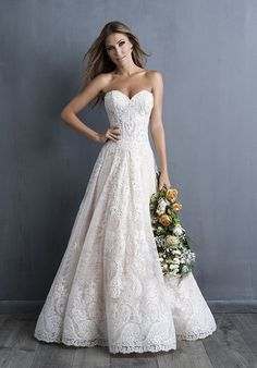 Lace intricately covers this strapless gown, from train to sweetheart bodice.