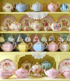 What a beautiful collection of vintage teapots in an array of pastel colors!