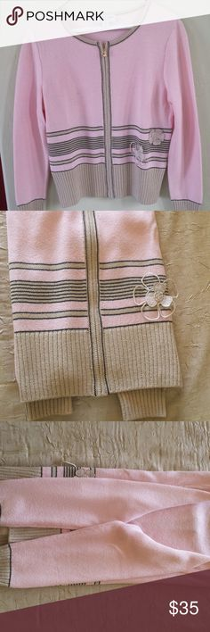 """St John Sport by Marie Gray Cardigan Sweater Lovely Pink sweater with tan and navy stripe detail and trim. Embroidered flower motif. Long sleeves  Full front zipper. 80% wool/20% Rayon. Size petite. Length 21""""/Sleeves 22""""/Armpit to armpit 18"""". Dry Cleaned. Smoke/pet free. St John Sweaters Cardigans"""