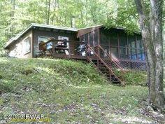 210 Florence Trl, Hawley, PA 18428 LAKEFRONT LOCATION, LOCATION, LOCATION! Very rare LAKE FLORENCE rustic cabin for sale. This property includes a share of an 88 acre preserve that surrounds this small community. The preserve is a hunter's paradise!!! The lake is quiet and beautiful. Comes with a dock, free sunbathing, row boating and all the fish you can catch. Enjoy!