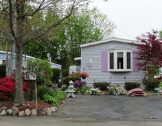 mobile home with colorful landscaping