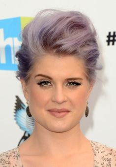 Kelly Osbourne's Pompadour Updo Hairstyle is another chic option for the pear-shaped face. And notice how she's created a strong brow for a more dramatic look that anchors the face. It's especially helpful in creating contrast (a youthful quality) if you have light hair and light skin.