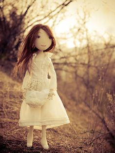 Beautiful hair and face on this handmade doll. It looks like the kind you can actually play with instead of sticking on a shelf.
