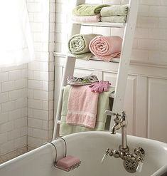 Ladder Instead of installing a typical metal rack to hold your towels, enlist a ladder. Chabby chic bathroom