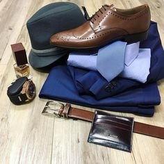 // NEW Lagerfeld blue suit NEW Hugo Boss shirt Spectrum tie NEW Brando shoes NEW Hugo Boss belt with Duro fragrance by Nasomatto Tie works hat Ted Baker wallet and Otumm watch.